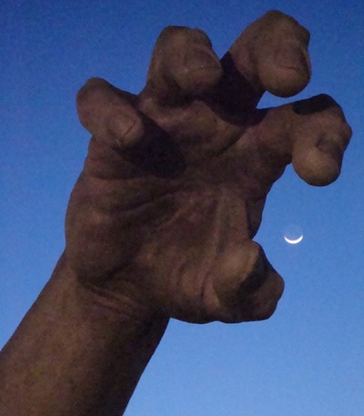 Moon and hand