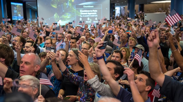 New Horizons crowd waving flags
