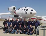 Scaled Composites employees pose in front of White Knight